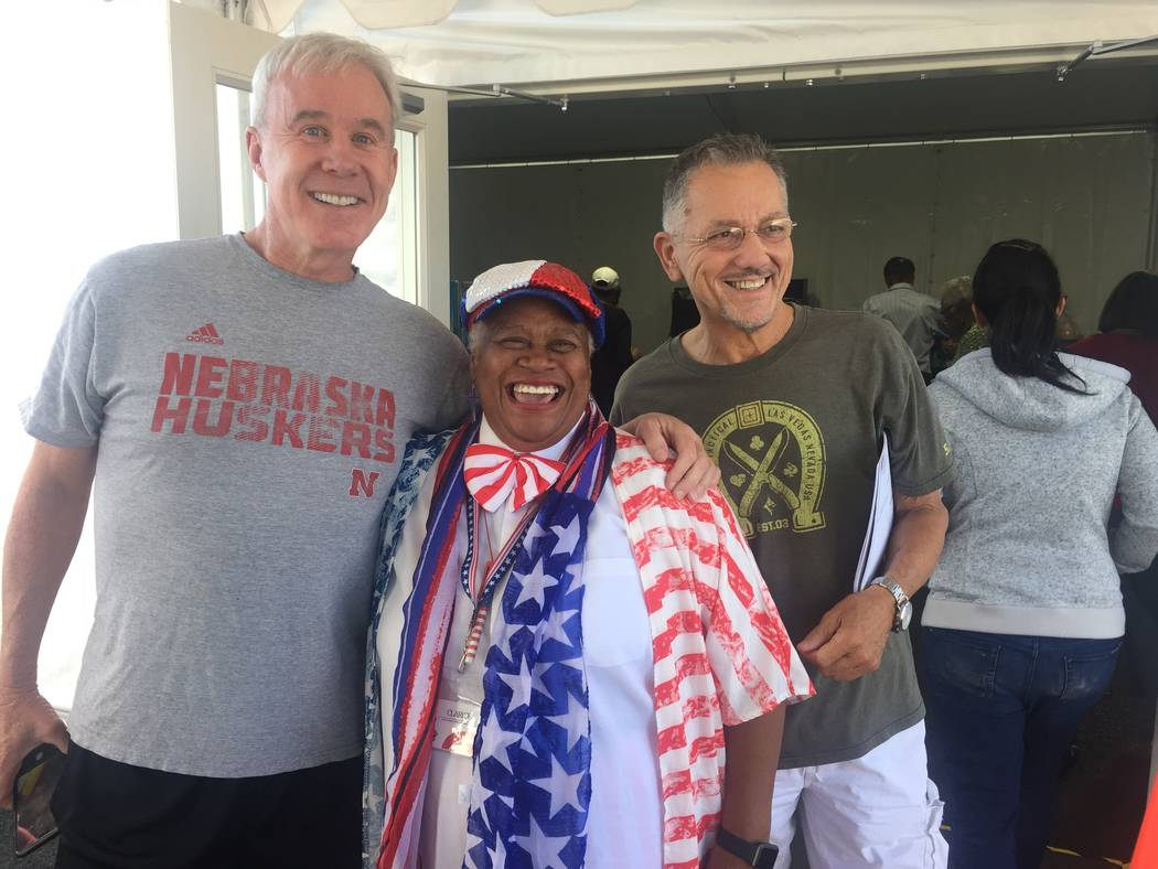 Voters Kevin Kean, left, poll worker Clarice Watkins and David Mecey celebrate the first day of early voting outside the Downtown Summerlin voting site Saturday morning. Marian Green/ Las Vegas Re ...