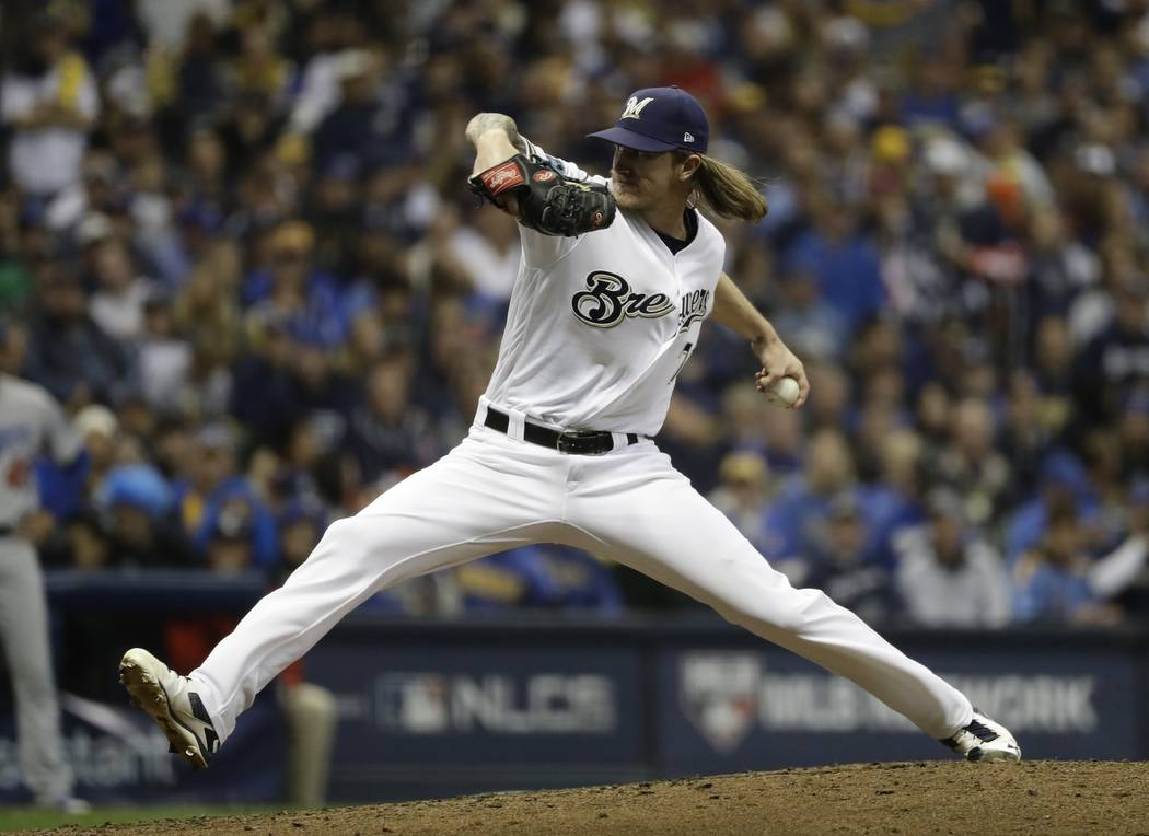 Milwaukee Brewers' Josh Hader throws during the third inning of Game 7 of the National League Championship Series baseball game against the Los Angeles Dodgers Saturday, Oct. 20, 2018, in Milwauke ...