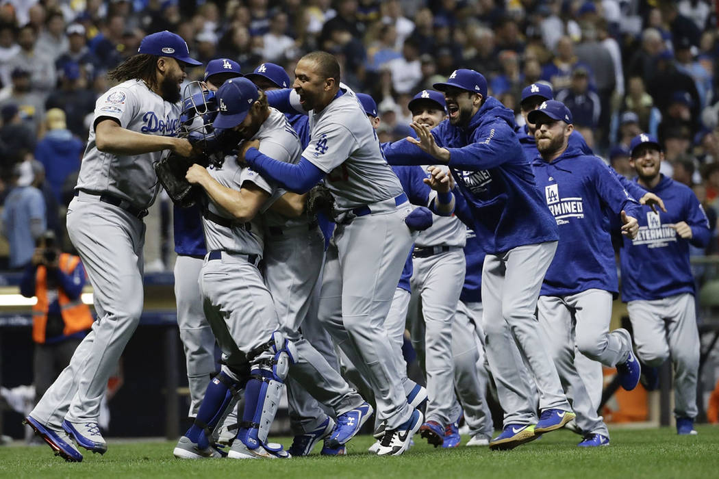 The Los Angeles Dodgers celebrate after Game 7 of the National League Championship Series baseball game against the Milwaukee Brewers Saturday, Oct. 20, 2018, in Milwaukee. The Dodgers won 5-1 to ...