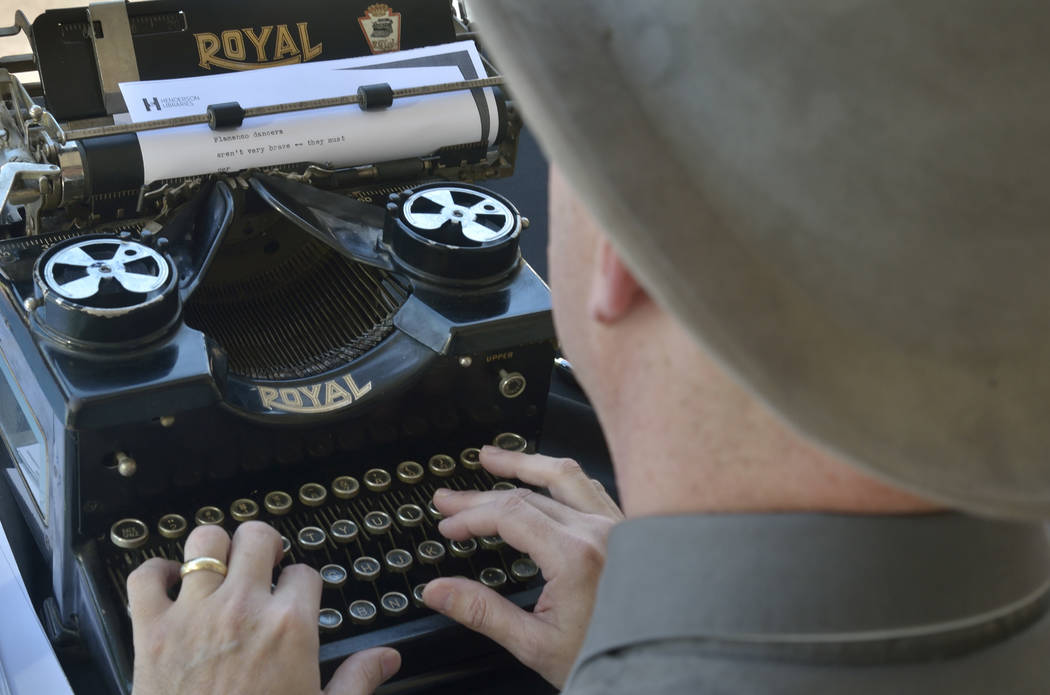 Author Sean Hoade works on a haiku on a 1940s-era Royal typewriter during the Las Vegas Book Festival at the Historic Fifth Street School at 401 S. 4th St. in Las Vegas on Saturday, Oct. 20, 2018. ...