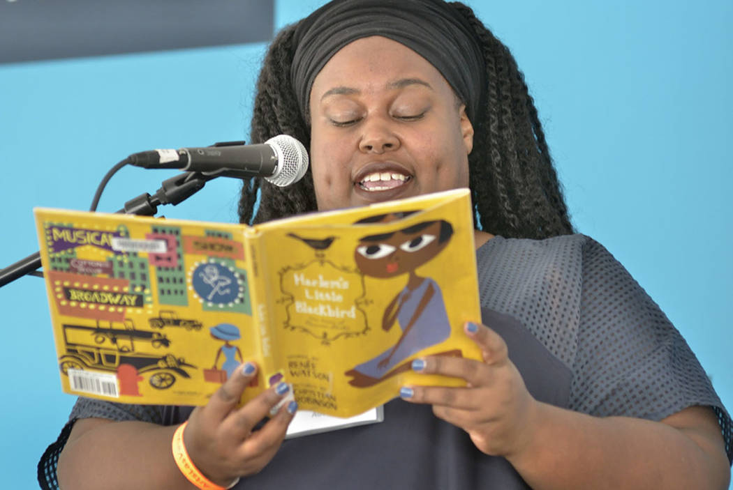 "Author Renée Watson reads from her book ""Harlem's Little Blackbird"" during the Las Vegas Book Festival at the Historic Fifth Street School at 401 S. 4th St. in Las Vegas ..."