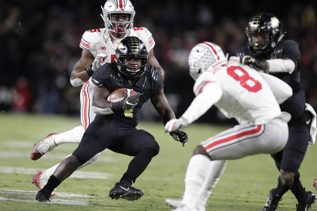 Purdue running back D.J. Knox (1) cuts in front of Ohio State cornerback Kendall Sheffield (8) during the first half of an NCAA college football game in West Lafayette, Ind., Saturday, Oct. 20, 20 ...