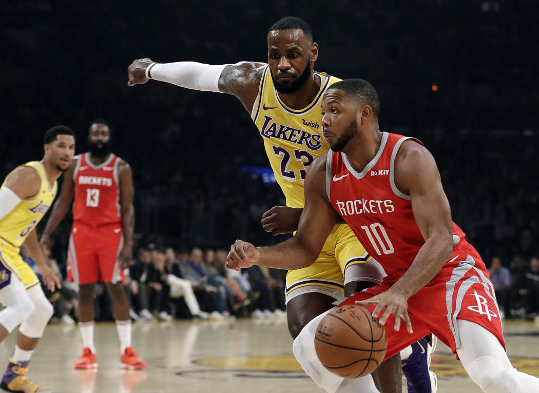 Los Angeles Lakers' LeBron James (23) defends on Houston Rockets' Eric Gordon (10) during the first half of an NBA basketball game Saturday, Oct. 20, 2018, in Los Angeles. (AP Photo/Marcio Jose Sa ...