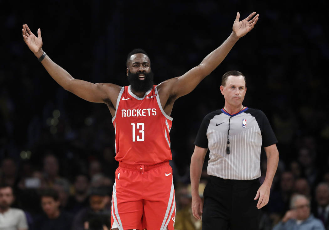 Houston Rockets' James Harden (13) raises his arms after a fouled is called against the Rockets during the first half of an NBA basketball game against the Los Angeles Lakers Saturday, Oct. 20, 20 ...