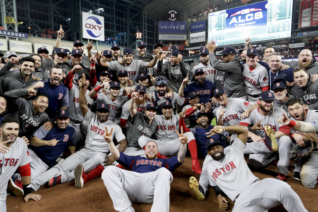 The Boston Red Sox pose for a picture after winning the baseball American League Championship Series against the Houston Astros on Thursday, Oct. 18, 2018, in Houston. Red Sox won 4-1. (AP Photo/D ...