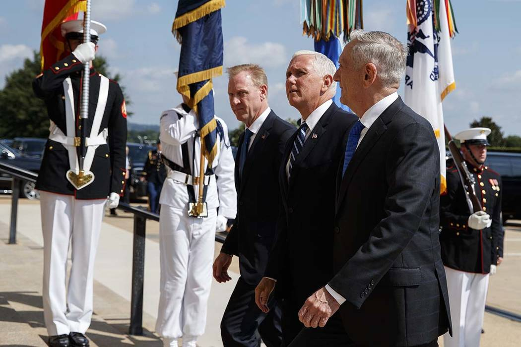 Vice President Mike Pence, center, is greeted by Deputy Secretary of Defense Pat Shanahan, left, and Secretary of Defense Jim Mattis before speaking at an event on the creation of a United States ...