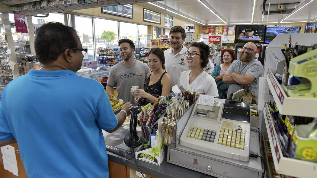 People line up at the Kwik Stop food store at 46th Avenue and Hollywood Boulevard, in Hollywood, Fla., to buy Mega Millions lottery tickets, Friday, Oct. 19, 2018. (Michael Laughlin/South Florida ...