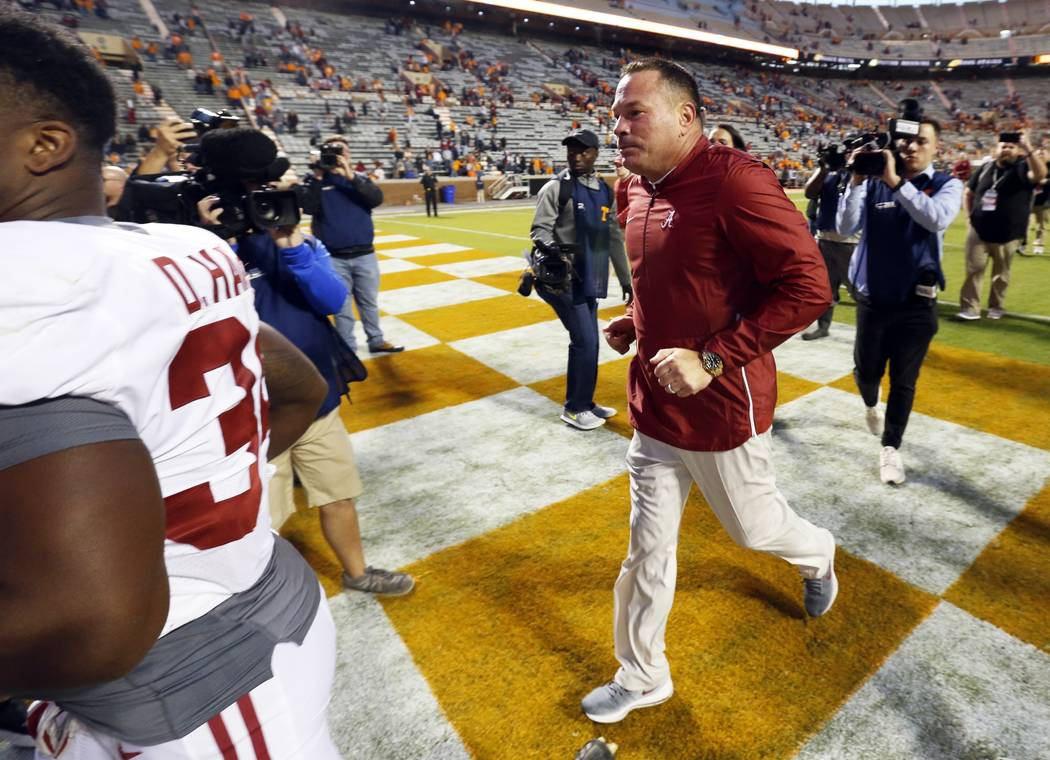 Former Tennessee head football coach Butch Jones leaves the field after an NCAA college football game against Tennessee Saturday, Oct. 20, 2018, in Knoxville, Tenn. Alabama won 58-21. (AP Photo/Wa ...