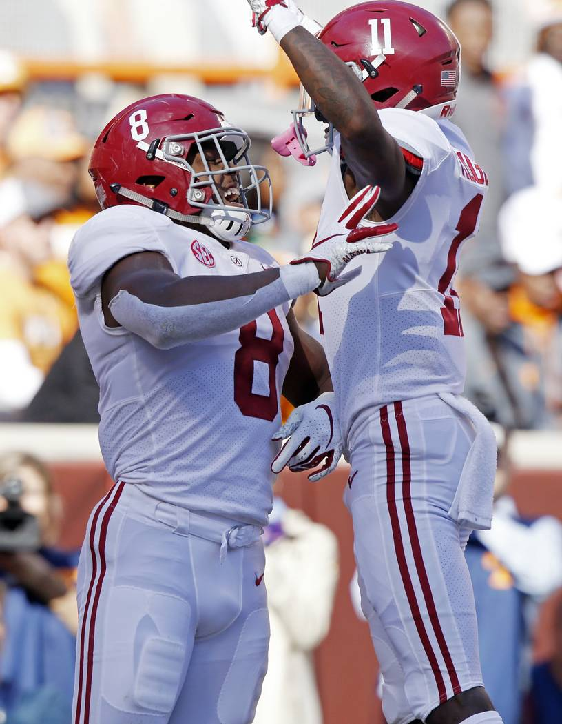 Alabama running back Josh Jacobs (8) celebrates a touchdown with teammate wide receiver Henry Ruggs III (11) in the first half of an NCAA college football game against Tennessee Saturday, Oct. 20, ...