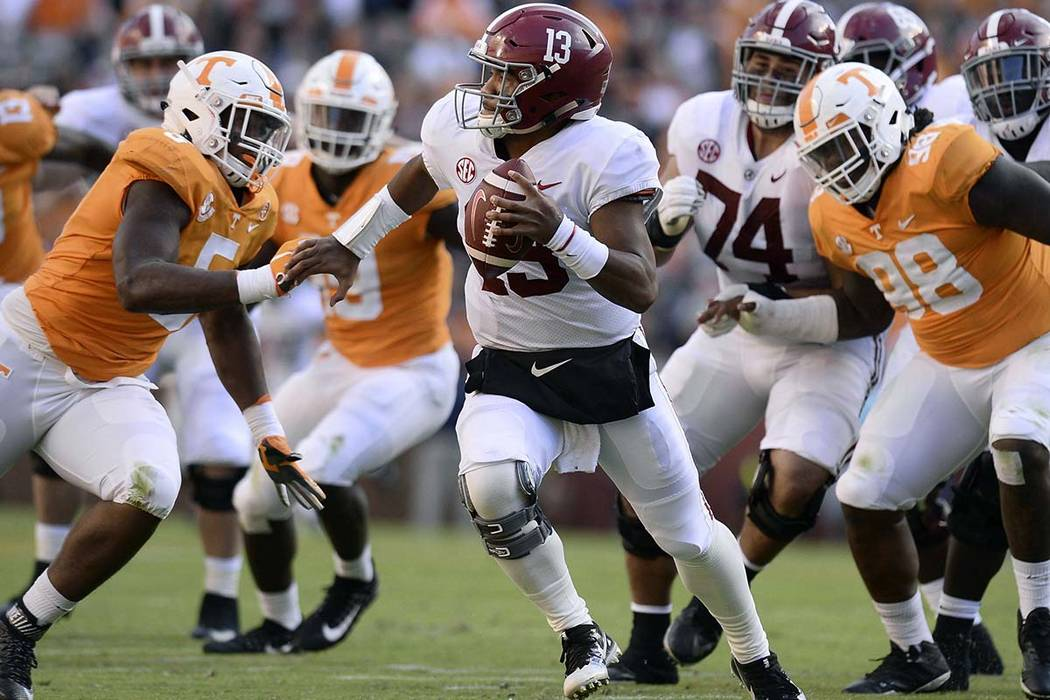 Tennessee defensive lineman Kyle Phillips (5) and Tennessee defensive lineman Alexis Johnson Jr. (98) go after Alabama quarterback Tua Tagovailoa (13) during the first half of an NCAA college foot ...