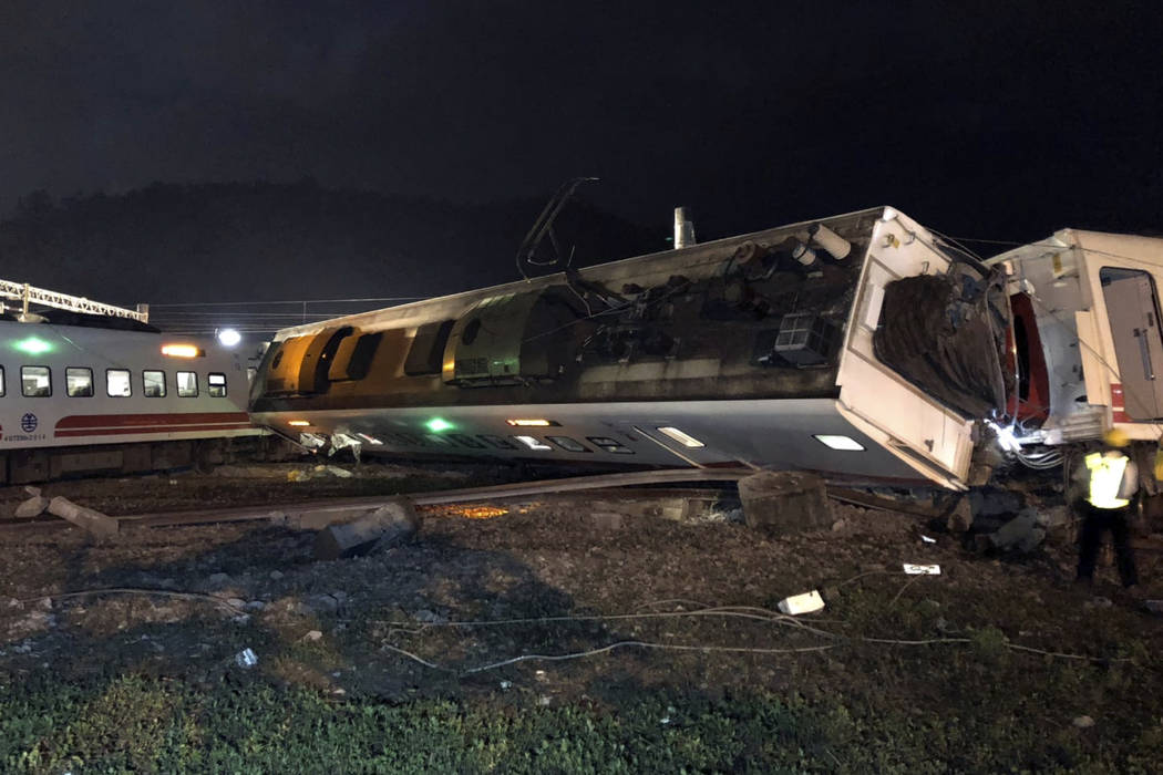 In this photo released by Taiwan Railways Administration, train carriages are scattered at the site of a train derailment in Lian in northern Taiwan on Sunday, Oct. 21, 2018. The Puyuma express tr ...