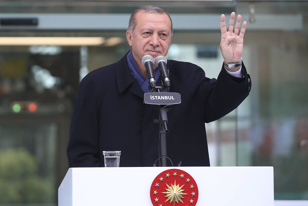 Turkish President Recep Tayyip Erdogan, waves following his speech at an opening ceremony for a new metro station in Istanbul, Sunday, Oct. 21, 2018. Erdogan says he will announce details of the T ...