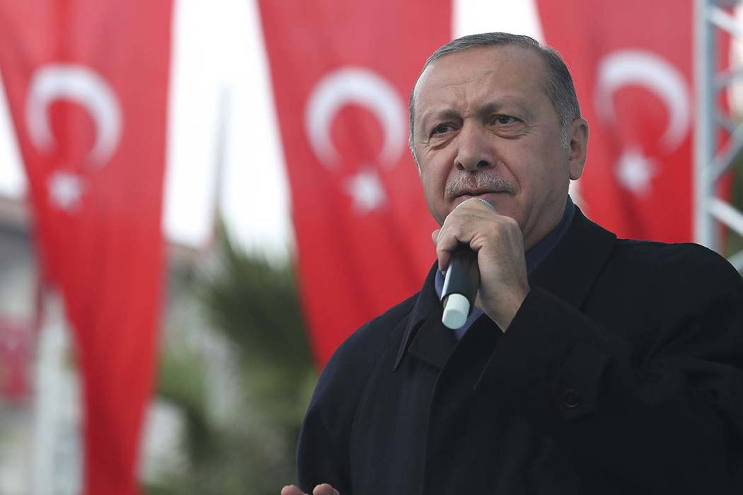 Turkish President Recep Tayyip Erdogan, delivers a speech at supporters in Istanbul, Sunday, Oct. 21, 2018. Erdogan says he will announce details of the Turkish investigation into the death of Sau ...