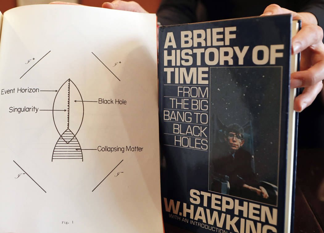 A Book, and scripts by Stephen Hawking are among the personal and academic possessions of Stephen Hawking at the auction house Christies in London, Friday, Oct. 19, 2018. (AP Photo/Frank Augstein)