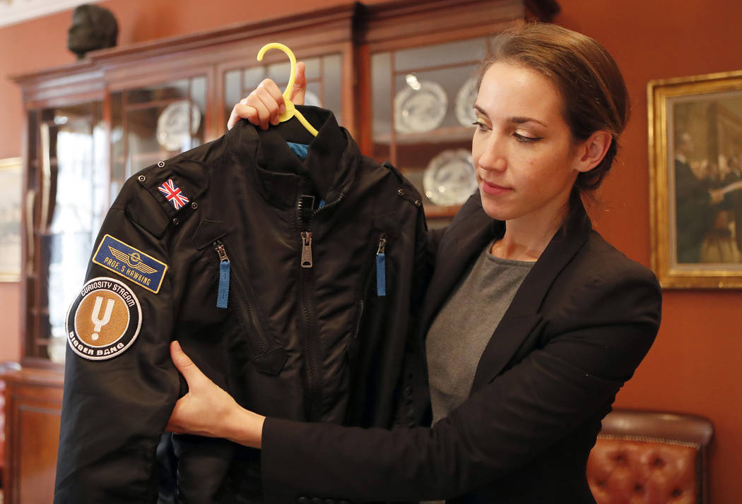 A bomber jacket given to Stephen Hawking is one of the personal and academic possessions of Stephen Hawking at the auction house Christies in London, Friday, Oct. 19, 2018. (AP Photo/Frank Augstein)
