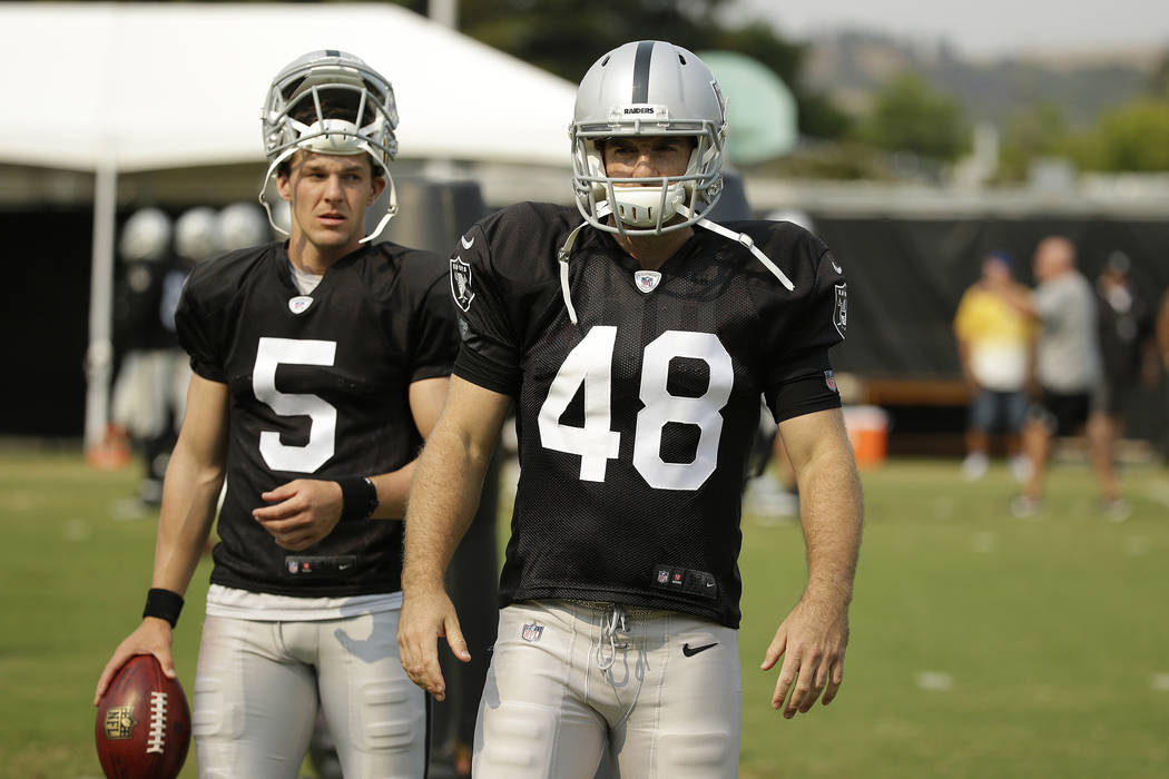 Oakland Raiders punter Johnny Townsend (5) and long snapper Andrew DePaola (48) during NFL football practice Tuesday, Aug. 7, 2018, in Napa, Calif. Both the Oakland Raiders and the Detroit Lions h ...