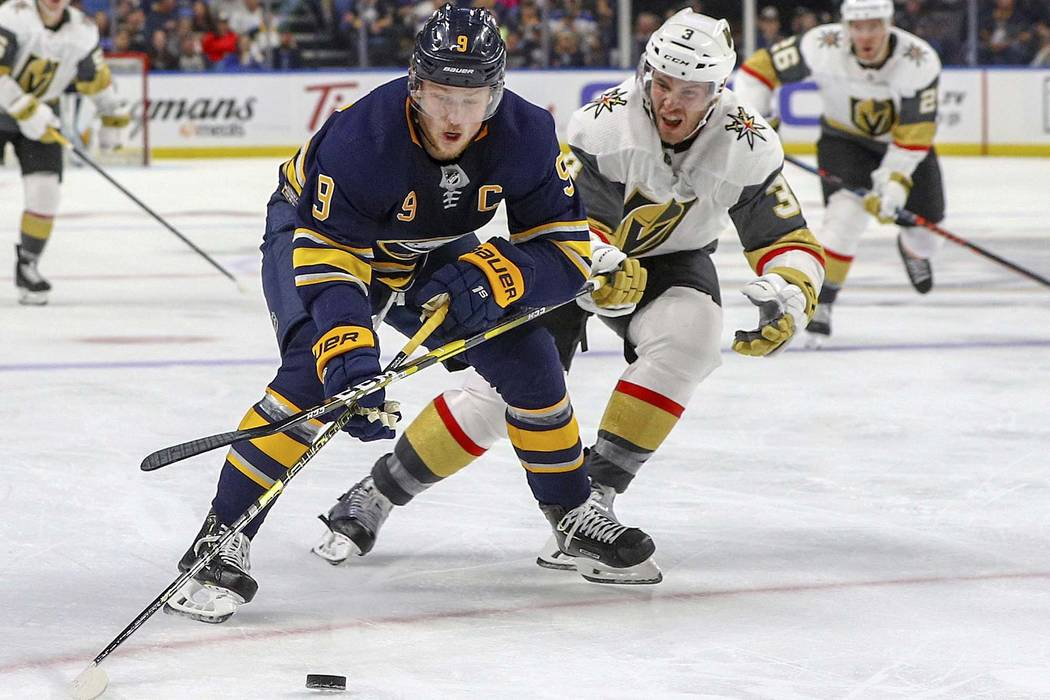 Buffalo Sabres center Jack Eichel (9) battles for the puck with Vegas Golden Knights defenseman Brayden McNabb (3) during the second period of play in an NHL hockey game between the Vegas Golden K ...