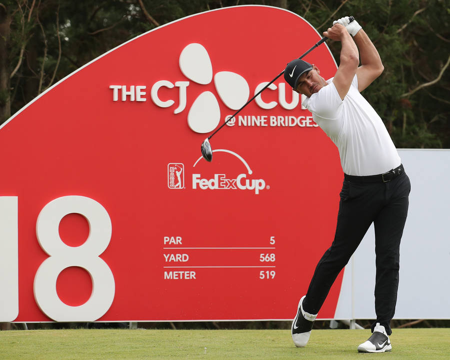 Brooks Koepka of the United States watches his shot on the 18th hole during the final round of the CJ Cup PGA golf tournament at Nine Bridges on Jeju Island, South Korea, Sunday, Oct. 21, 2018. (P ...