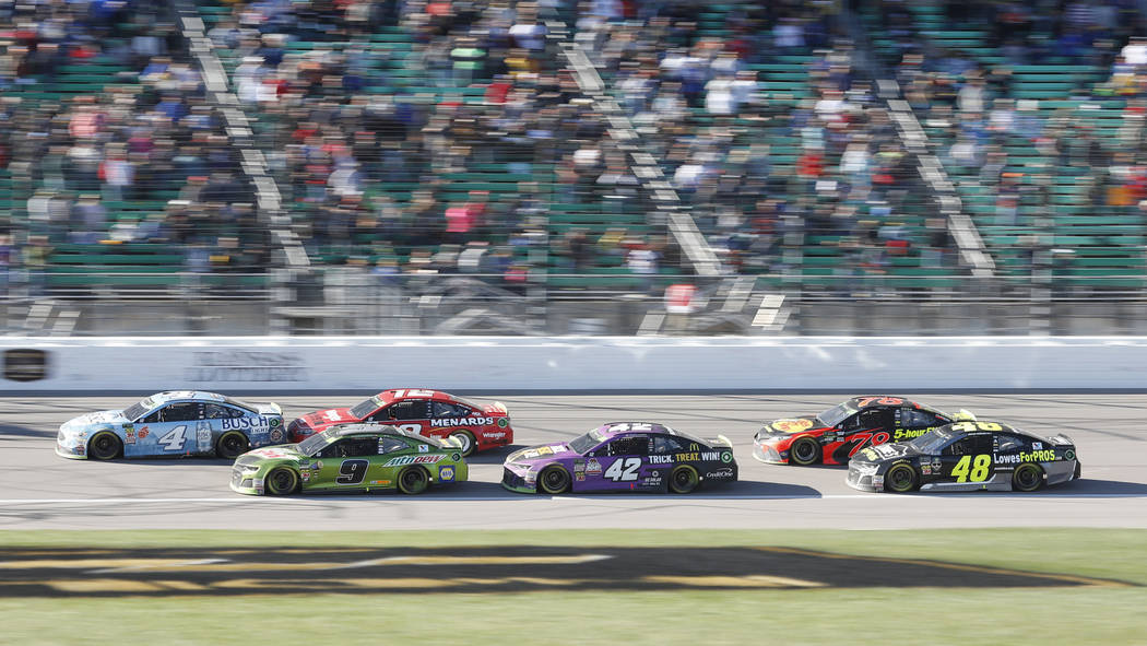 Kevin Harvick (4) leads with Chase Elliott (9) in second place at the start of the third stage during a NASCAR Cup Series auto race at Kansas Speedway in Kansas City, Kan., Sunday, Oct 21, 2018. E ...