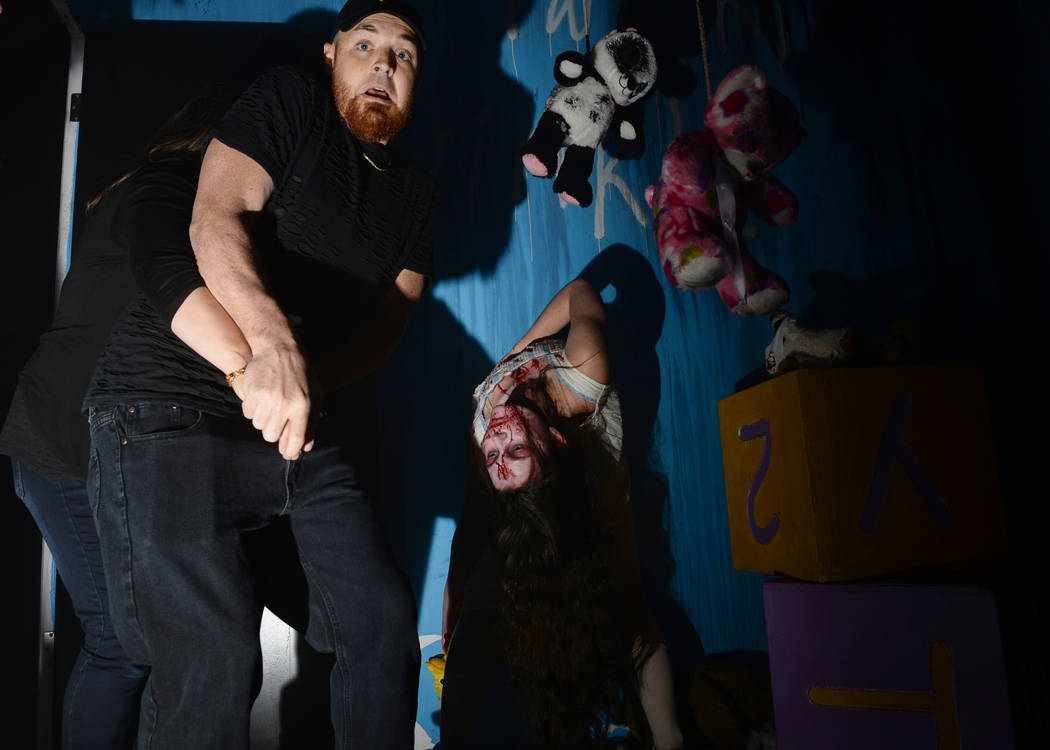 Visitors of Vegas Freight Nights walk through a haunted house at Opportunity Village's Magical Forest in Las Vegas, Sunday, Oct. 21, 2018. Caroline Brehman/Las Vegas Review-Journal