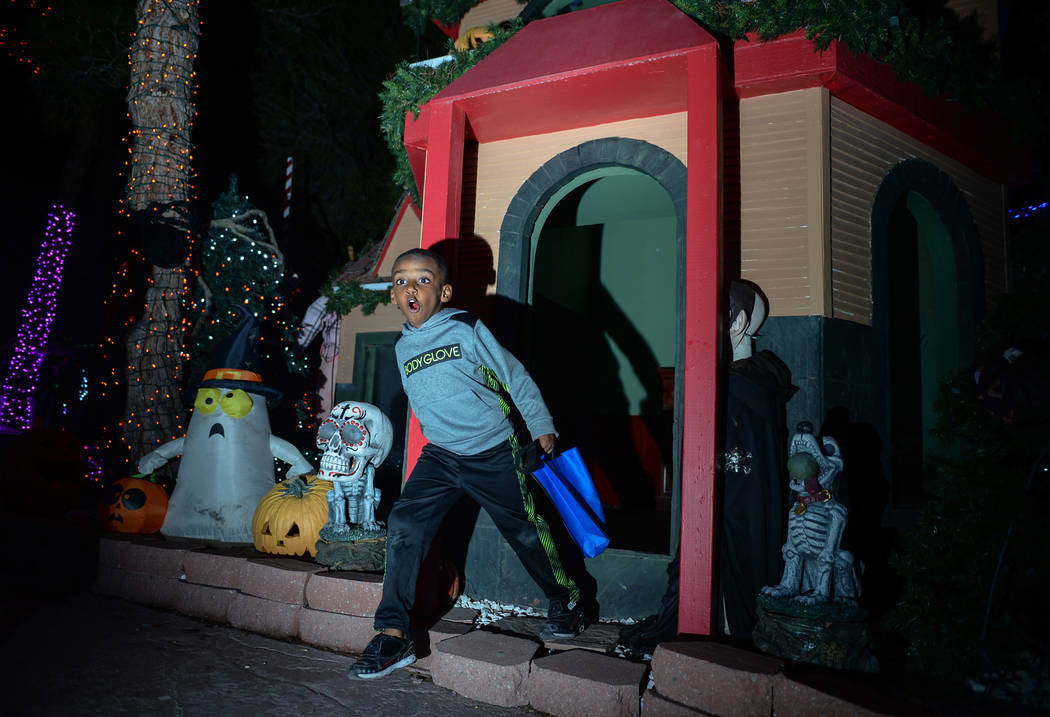 Noel Work, 4, steps out of a shed set up for HallOVeen at Opportunity Village's Magical Forest in Las Vegas, Sunday, Oct. 21, 2018. Caroline Brehman/Las Vegas Review-Journal