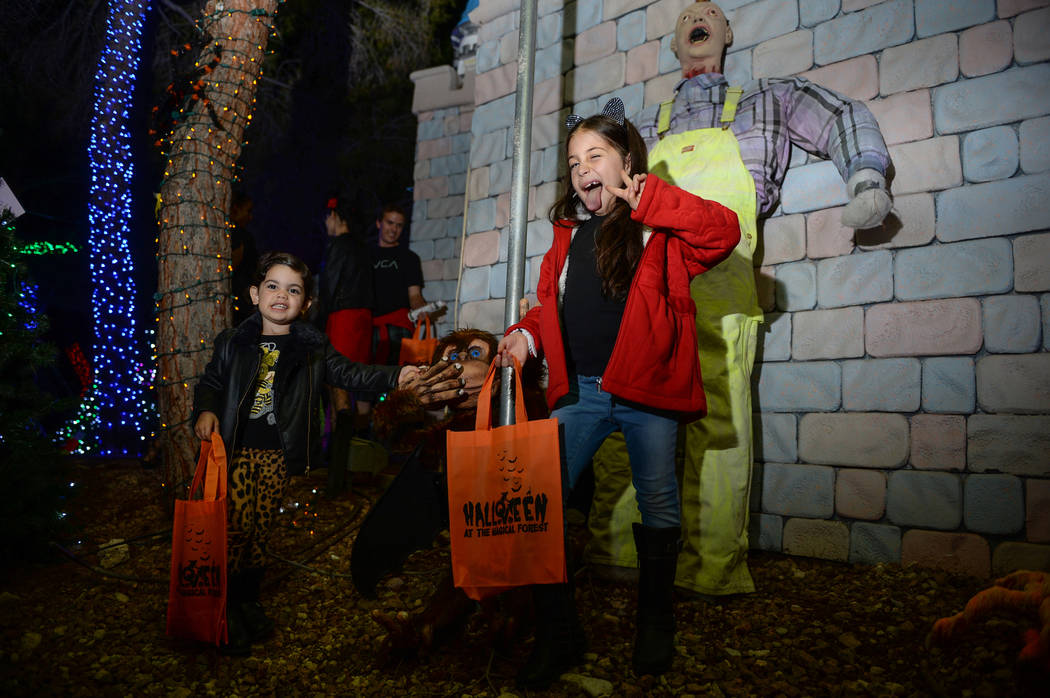 Cheyenne Prives, 3, and Amy Prives, 8 pose for a photograph at the HallOVeen event at Opportunity Village's Magical Forest in Las Vegas, Sunday, Oct. 21, 2018. Caroline Brehman/Las Vegas Review-Jo ...