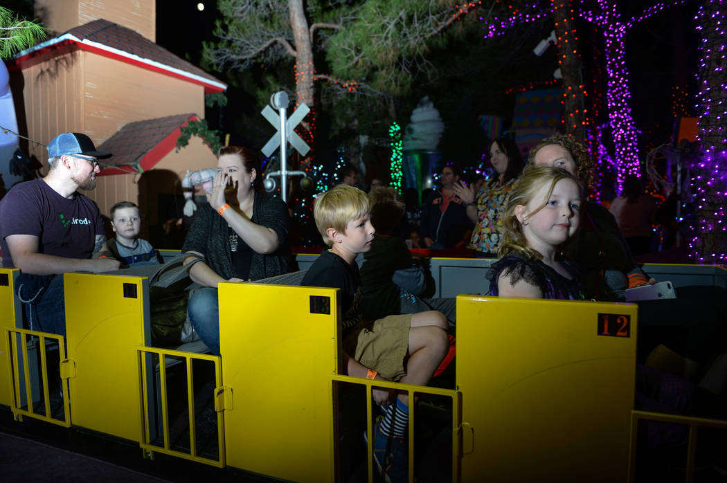 Visitors gathered for HallOVween at Opportunity Village's Magical Forest ride a train through the grounds in Las Vegas, Sunday, Oct. 21, 2018. Caroline Brehman/Las Vegas Review-Journal