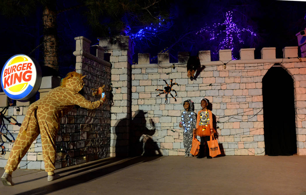 Serena Garrett, left, takes a photograph of Anahi Crockett, 5, and Addison Reed, 5 at the HallOVeen event at Opportunity Village's Magical Forest in Las Vegas, Sunday, Oct. 21, 2018. Caroline Breh ...