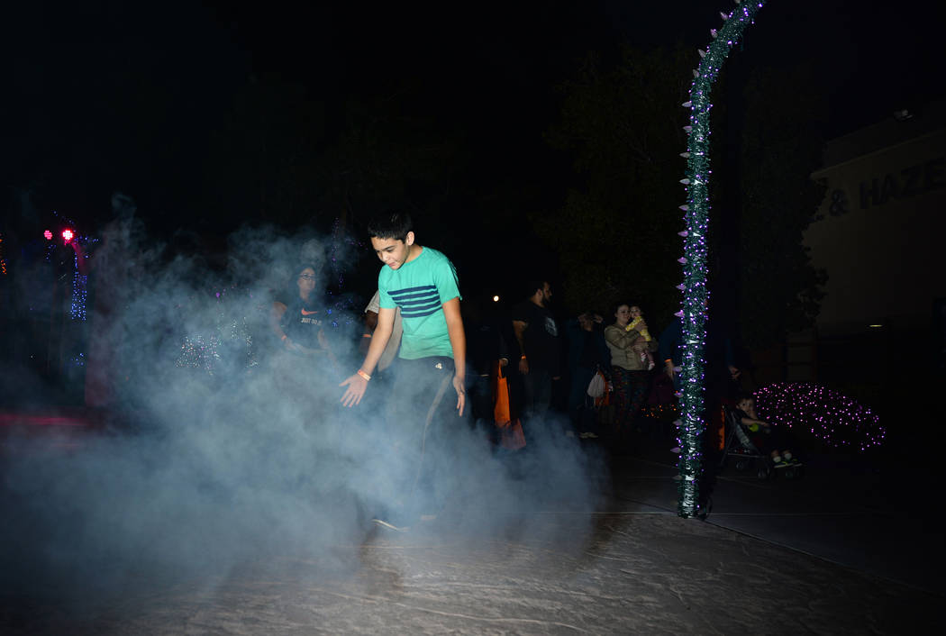 Daniel Delagarza walks through a cloud of fog at the HallOVween event taking place at Opportunity Village's Magical Forest in Las Vegas, Sunday, Oct. 21, 2018. Caroline Brehman/Las Vegas Review-Jo ...