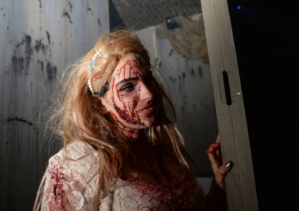 An actor peers around the corner at Vegas Freight Nights' haunted house at Opportunity Village's Magical Forest in Las Vegas, Sunday, Oct. 21, 2018. Caroline Brehman/Las Vegas Review-Journal