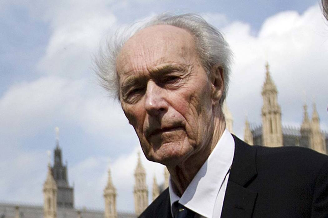 In this Thursday, April 25, 2013 file photo, Norwegian war hero and resistance fighter Joachim Roenneberg walks in a park near the Palace of Westminster, after receiving the Union Jack Medal for h ...