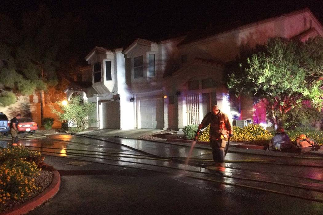Firefighters clean up after a condo fire Sunday night in northwest Las Vegas. (Las Vegas Fire & Rescue)