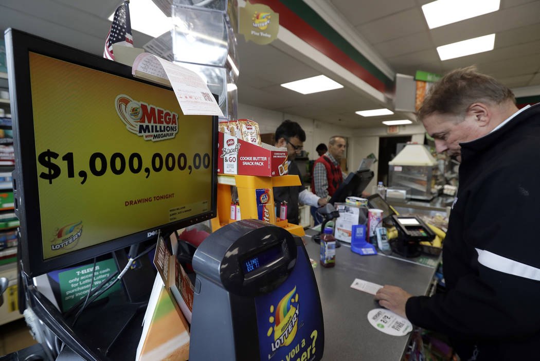 A sign displays the estimated Mega Millions jackpot at a convenience store in Chicago, Friday, Oct. 19, 2018. Friday's jackpot has soared to $1 billion, the second-largest prize in U. S. lottery h ...