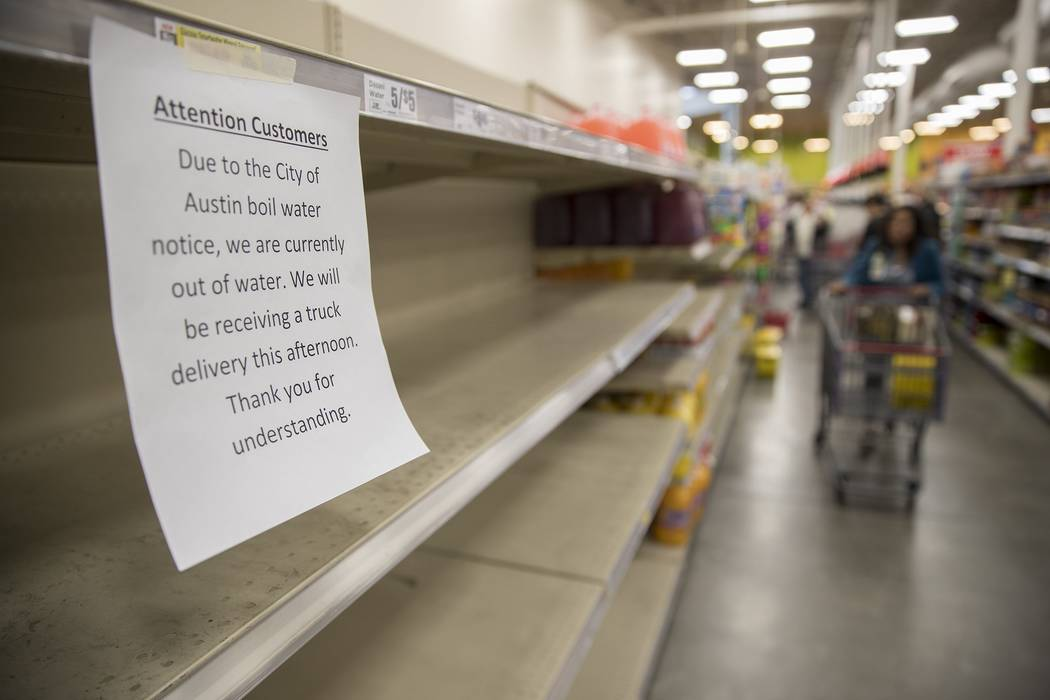 Empty shelves where water was sold at the H-E-B in Austin, Texas on Monday, October 22, 2018. The city of Austin's water utility told all residents early Monday to boil water before using until th ...