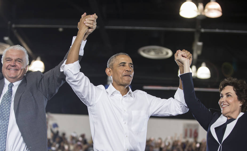 Clark County Commission Chairman Steve Sisolak, left, former President Barack Obama and Democratic Congresswoman Jacky Rosen salute the crowd during a rally at Cox Pavilion on Monday, Oct. 22, 201 ...