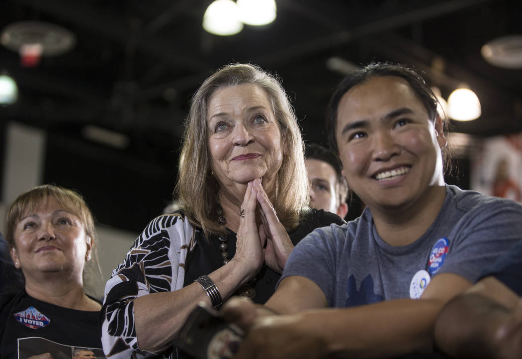 Deb Lomando, middle, listens to former President Barack Obama speak during a rally at Cox Pavilion on Monday, Oct. 22, 2018, in Las Vegas. Benjamin Hager Las Vegas Review-Journal