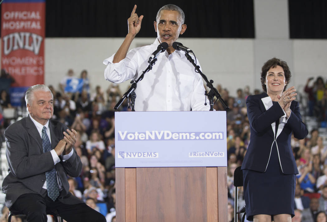 Former President Barack Obama, middle, speaks during a rally at Cox Pavilion on Monday, Oct. 22, 2018, in Las Vegas. Benjamin Hager Las Vegas Review-Journal
