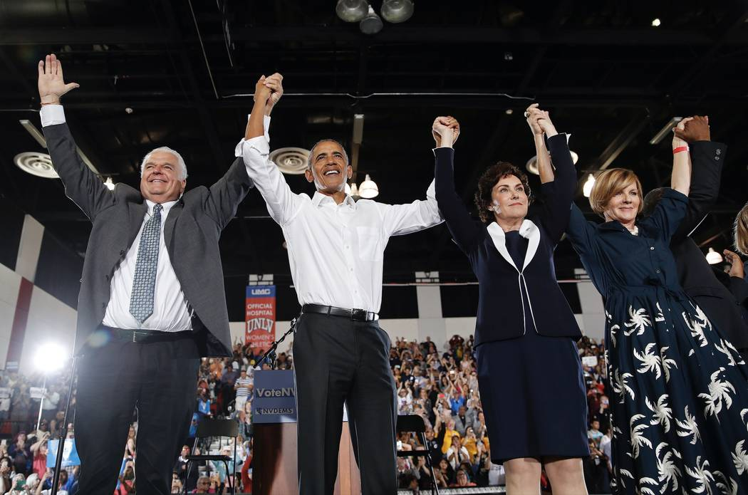 Former President Barack Obama, second from left, cheers at a rally in support of Clark County Commission Chair and Democratic gubernatorial candidate Steve Sisolak, left, candidate for Senate Jack ...