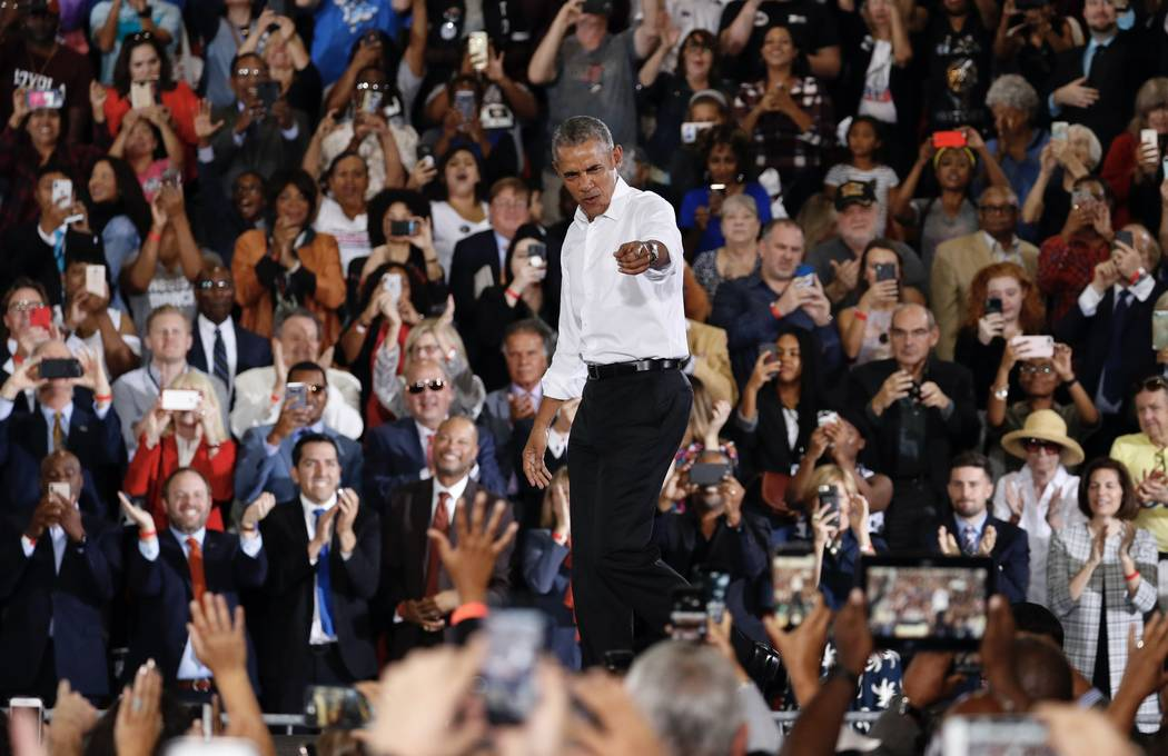 Former President Barack Obama reacts as he walks on stage at a rally in support of candidate for Senate Jacky Rosen and other Nevada Democrats, Monday, Oct. 22, 2018, in Las Vegas. (AP Photo/John ...