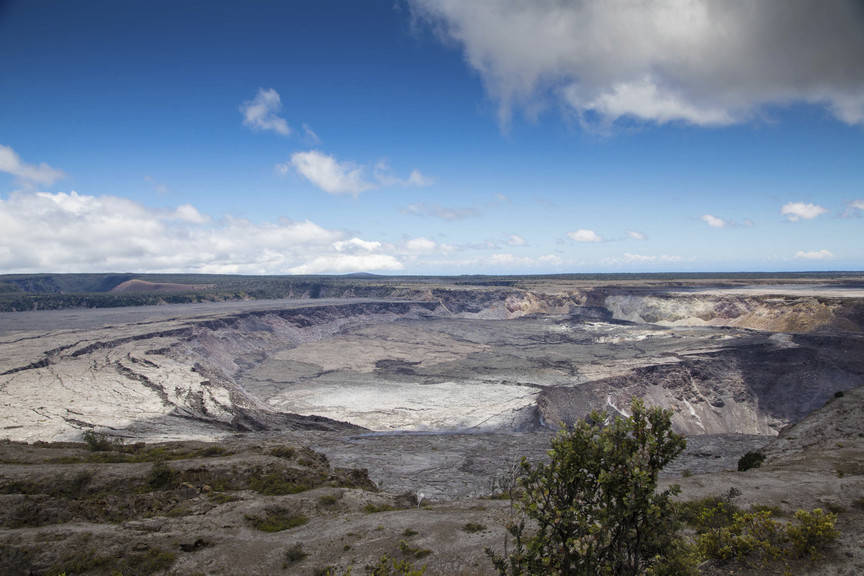 Halemaumau Crater, which has quadrupled in size since May, and Kilauea Caldera at Kilauea volcano's summit are seen inside Hawaii Volcanoes National Park in Hawaii on Friday, Aug. 17, 2018. (Janic ...
