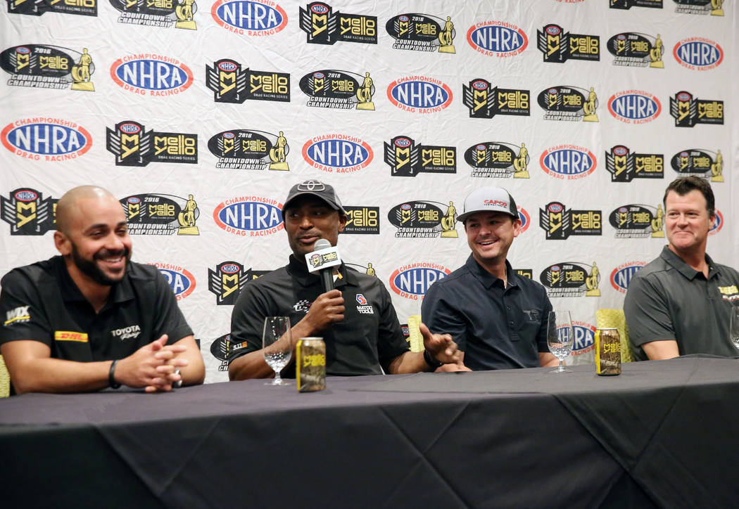 Top Fuel driver Antron Brown, second left, speaks as drivers J.R. Todd, left, Steve Torrence and Jeg Coughlin Jr. look on during media day on Thursday, Oct. 25, 2018, in Las Vegas. Bizuayehu Tesfa ...