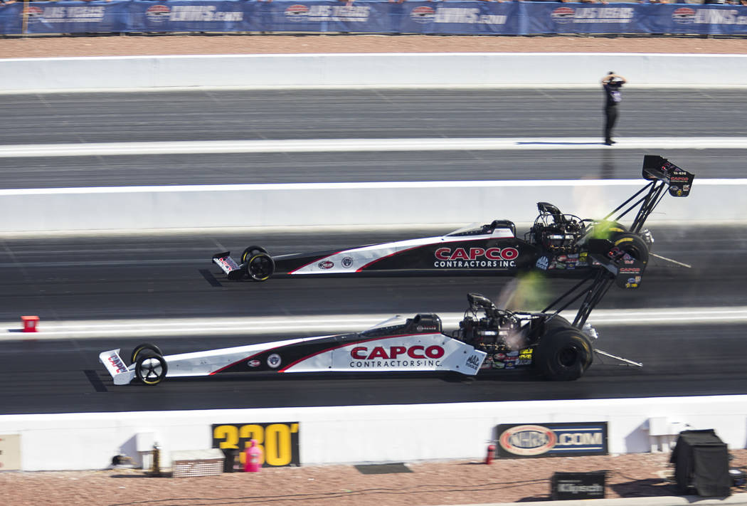 NHRA Top Fuel Dragster drivers Steve Torrence, bottom, and his dad, Bily Torrence, compete in the final eliminations during the NHRA Toyota Nationals at The Strip at Las Vegas Motor Speedway on Su ...