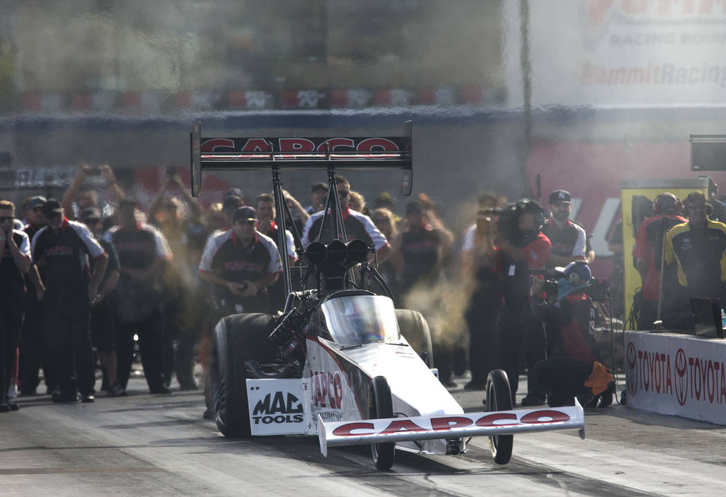 NHRA Top Fuel Dragster drivers Steve Torrence and Richie Crampton (not shown) compete in the final eliminations during the NHRA Toyota Nationals at The Strip at Las Vegas Motor Speedwayon Sunday, ...
