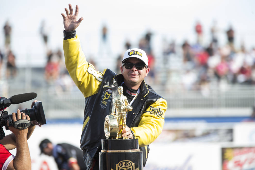 NHRA Top Fuel Dragster champion Steve Torrence celebrates after winning the race and the season's Top Fuel championship at NHRA Toyota Nationals at The Strip at Las Vegas Motor Speedway on Sunday, ...