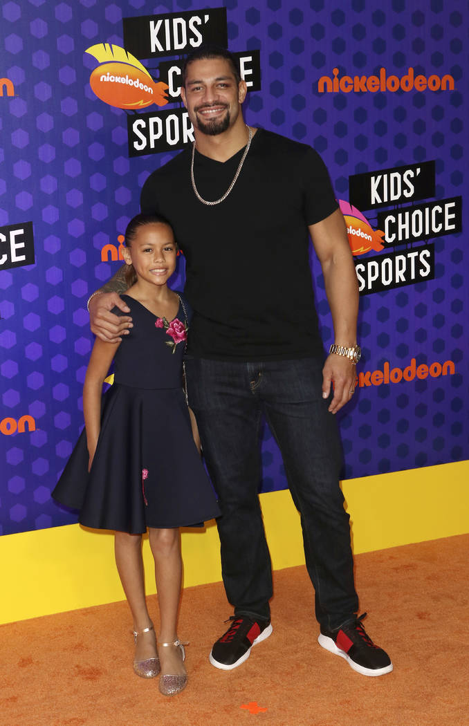 Roman Reigns, right, and Joelle Anoa'i arrives at the Kids' Choice Sports Awards at the Barker Hangar on Thursday, July 19, 2018, in Santa Monica, Calif. (Photo by Willy Sanjuan/Invision/AP)