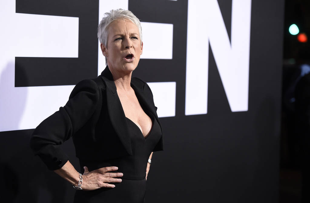 """Jamie Lee Curtis, star of """"Halloween,"""" banters with photographers at the premiere of the film at the TCL Chinese Theatre, Wednesday, Oct. 17, 2018, in Los Angeles. (Photo by Chris Pizzel ..."""