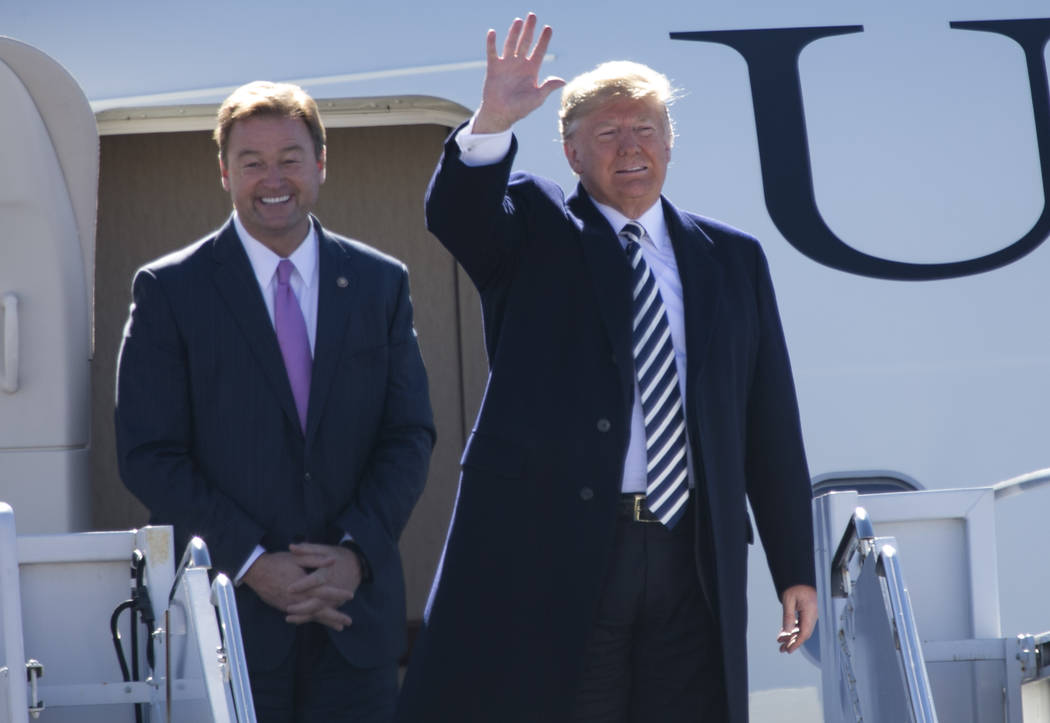 President Donald Trump, right, arrives with Sen. Dean Heller, R-Nev., on Air Force One before a Make America Great Again Rally in Elko, Nev., on Saturday, Oct. 20, 2018. Richard Brian Las Vegas Re ...