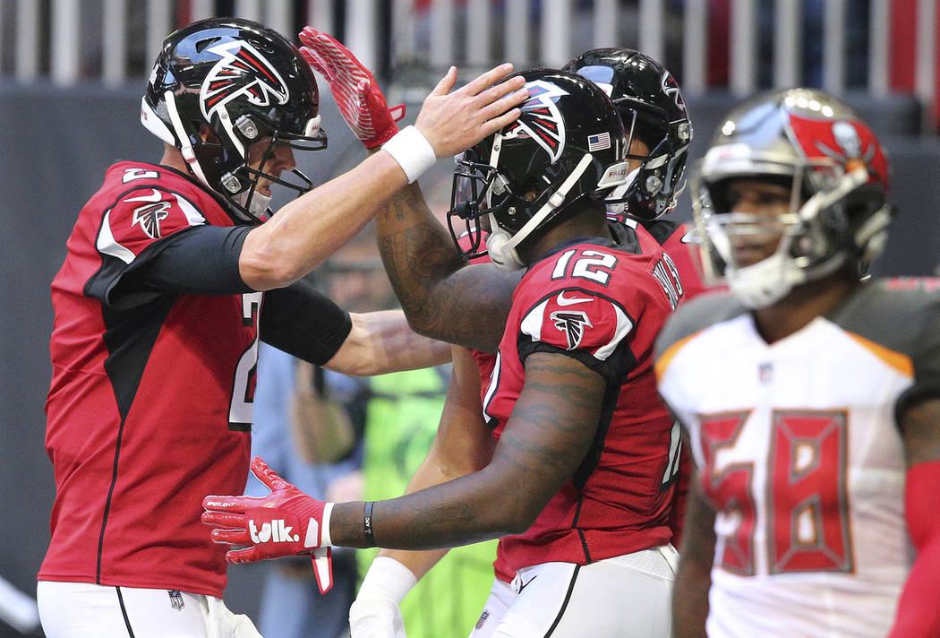 Atlanta Falcons quarterback Matt Ryan, left, and wide receiver Mohamed Sanu celebrate a first-half touchdown against the Tampa Bay Buccaneers during an NFL football game Sunday, Oct 14, 2018, in A ...