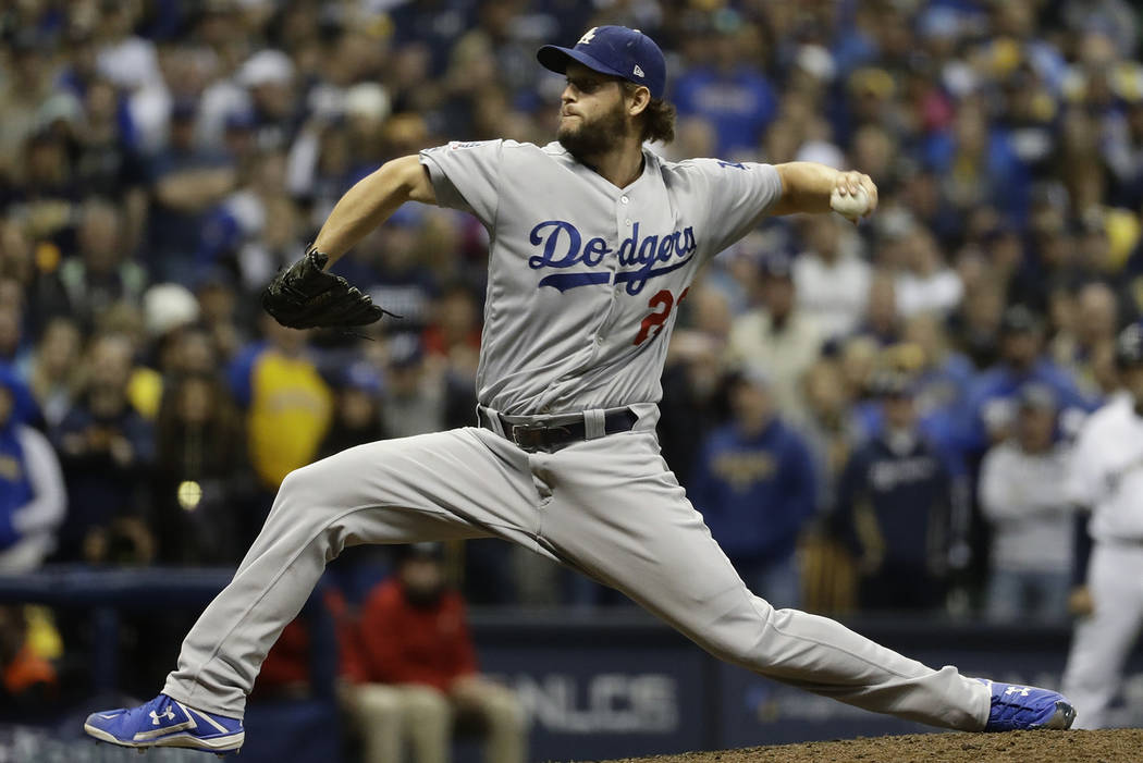 Los Angeles Dodgers' Clayton Kershaw throws during the ninth inning of Game 7 of the National League Championship Series baseball game against the Milwaukee Brewers Saturday, Oct. 20, 2018, in Mil ...
