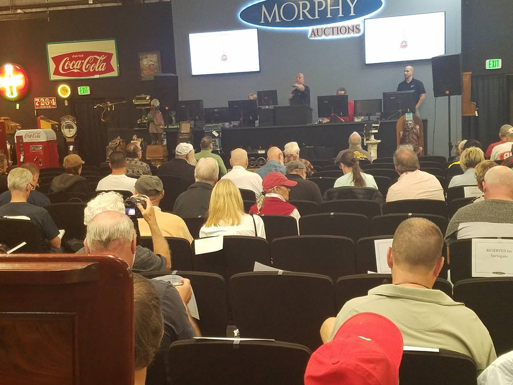 Dan Morphy of Morphy Auctions, Denver, Pennsylvania, conducts bidding for items at a two-day coin-op and advertising auction in Las Vegas on Saturday, Oct. 20, 2018. (Richard N. Velotta/Las Vegas ...
